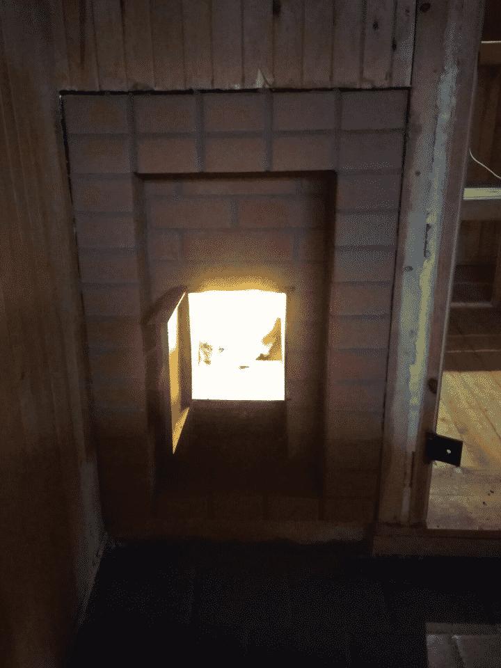 банная печь костер с открытой дверцей