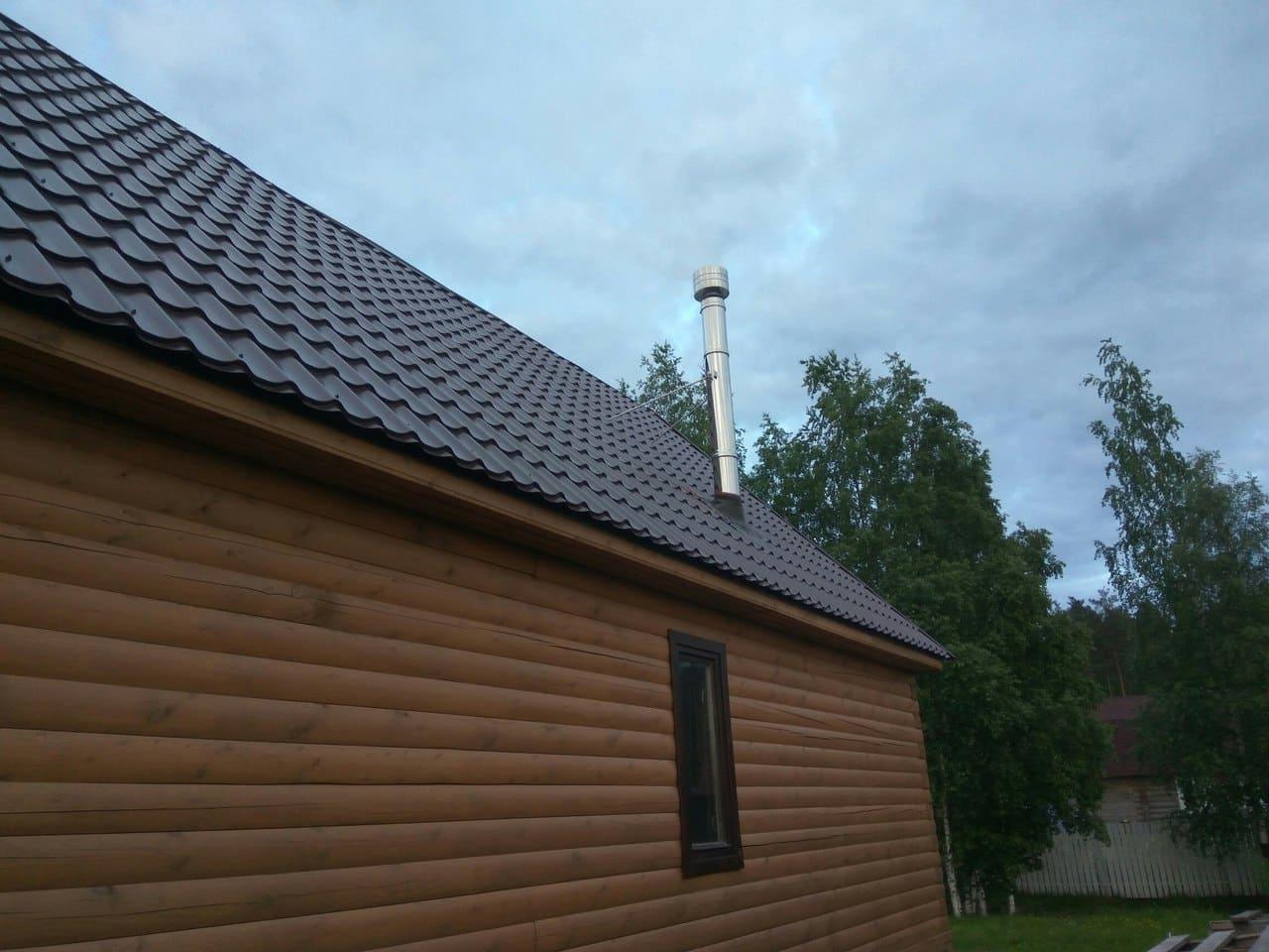 загородный дом дымоход на крыше