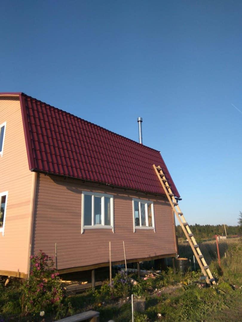 загородный дом красная крыша чистое небо
