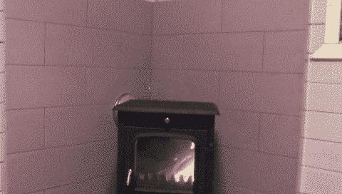 установка чугунной печки в коттедже
